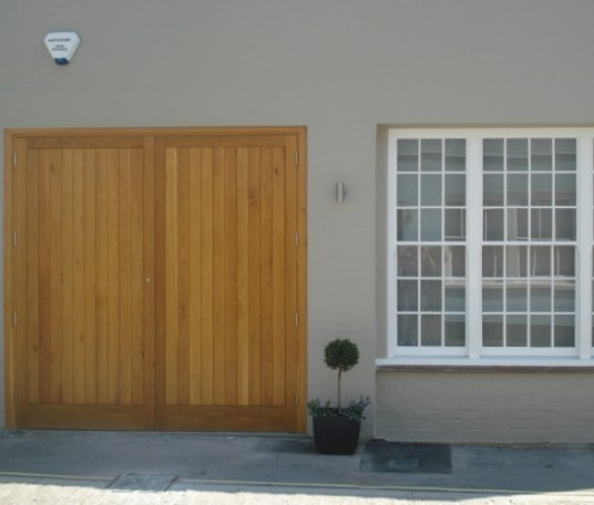 Draught-proof oak front door with tongue and groove detailing.