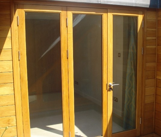 A rebated French door system crafted in oak and sealed with hand varnishing.