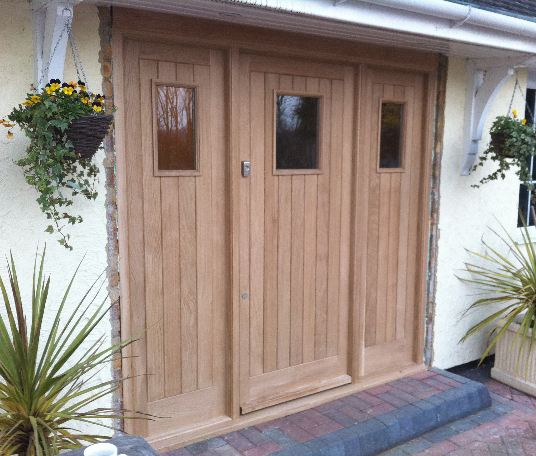 Front door created with European hard wood oak.  The addition of tongue and groove panels were used to create an extra element of detailing. The doors were completed with a spray finish.