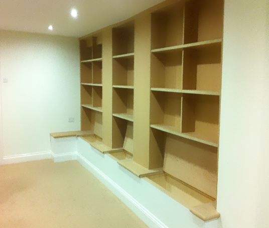 Fly-lined storage units with custom made book space above.